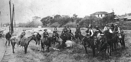 Men on horses in a historical photograph